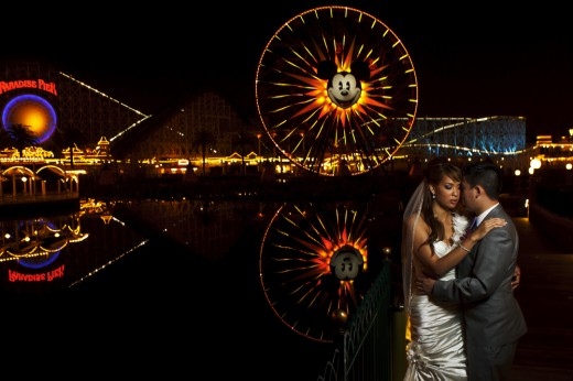 Wedding couple standing at Paradise Pier