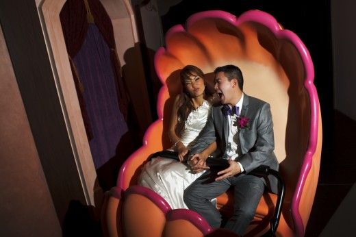 Wedding couple riding The Little Mermaid attraction