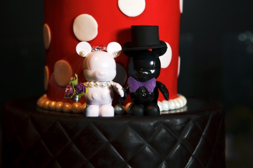 Bride and groom Vinylmations on a Disneyland wedding cake