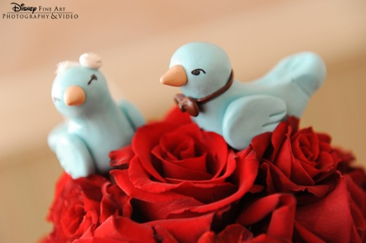 Blue bird cake topper at a Disney's Fairy Tale Wedding